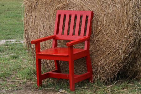 red wood chair and straw Stock Photo - 15219177