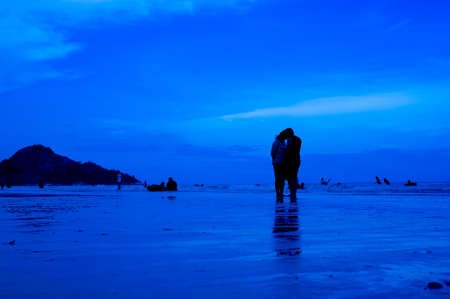 siluet people walking on the beach blue background Stock Photo - 15218996
