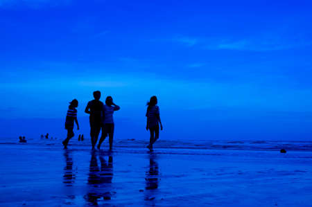 siluet people walking on the beach blue background Stock Photo - 15219000