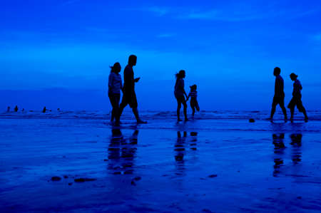 siluet people walking on the beach blue background Stock Photo - 15219008