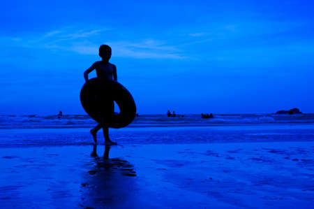 siluet people walking on the beach blue background Stock Photo - 15219041