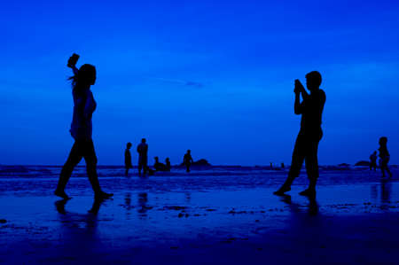siluet people walking on the beach blue background Stock Photo - 15219011