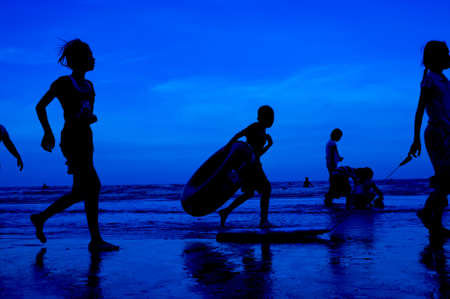 siluet people walking on the beach blue background Stock Photo - 15219009