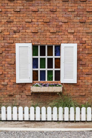 white retro window on the red brick wall photo