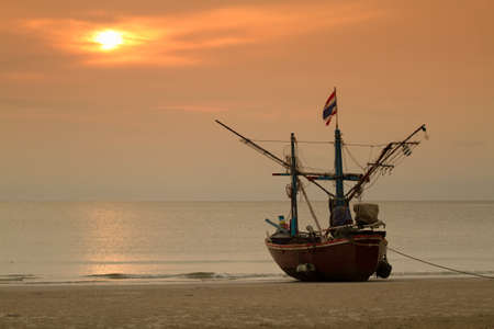 Fisher boat on Hua Hin beach  sunrise background Thailand