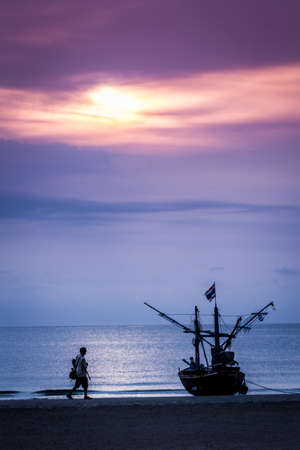 Fisher boat on Hua Hin beach  sunrise background Thailand