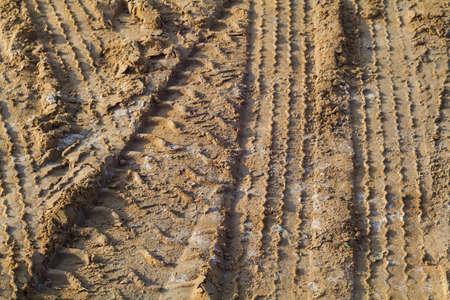 Tire track on muddy road