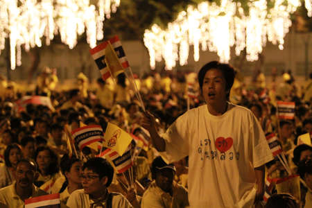 BANGKOK ,THAILAND - DECEMBER 5: Unidentified Hundreds of thousands of people thronged the Royal Plaza to help celebrate HM's 85th birthday; the King is the world's longest-reigning monarch. His Majesty ended his birthday speech delivered to all well-wishe Stock Photo - 16769202