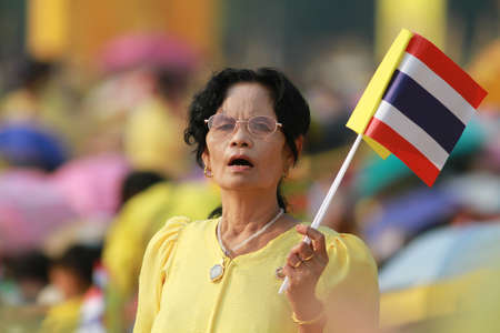 BANGKOK ,THAILAND - DECEMBER 5: Unidentified Hundreds of thousands of people thronged the Royal Plaza to help celebrate HM's 85th birthday; the King is the world's longest-reigning monarch. His Majesty ended his birthday speech delivered to all well-wishe Stock Photo - 16870758