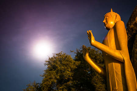 Big Buddha Statue in Night with moon photo