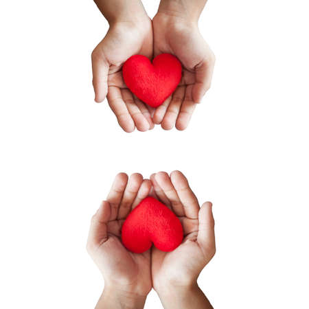 give: hands hold a red heart on white background