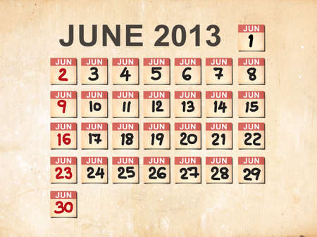 June 2013 calendar on old paper texture background photo