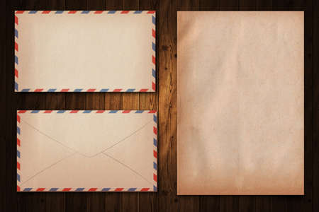 vintage letter paper and enlelope on wood  background photo
