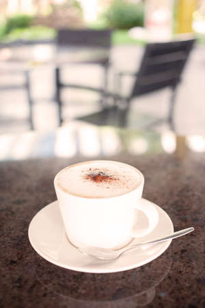 cup of coffee with milk warm tone close up  photo