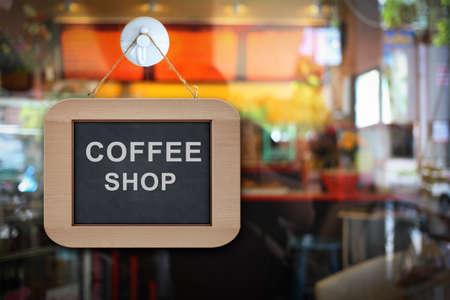 the banner sign hang on the door in coffee shop
