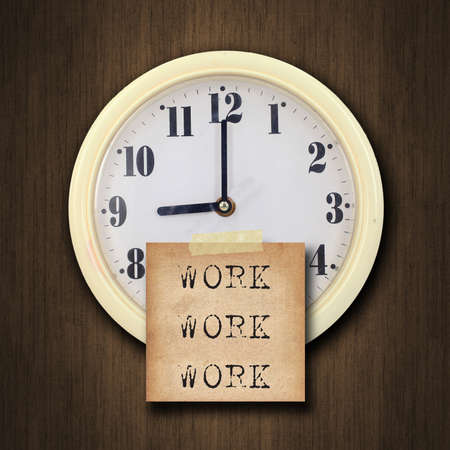 oclock: text work on the nine oclock on the wall clock  with the old paper short note on wood background
