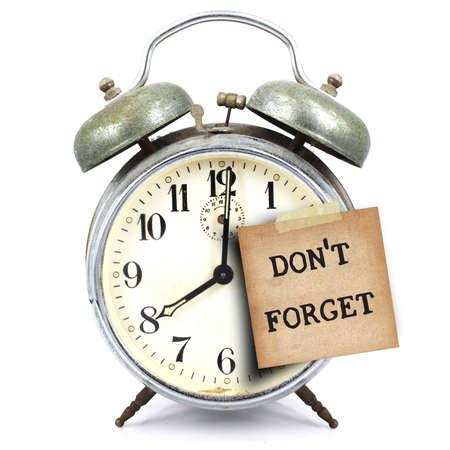 text dont forget on vintage retro alarm clock and short note on white background 版權商用圖片
