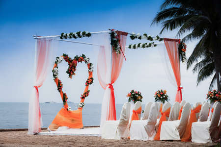 anniversary beach: Beach Wedding Ceremony orange color theme