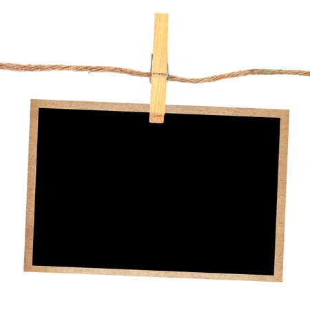 instant film transfer: old photo and clothes peg  isolated white background Stock Photo