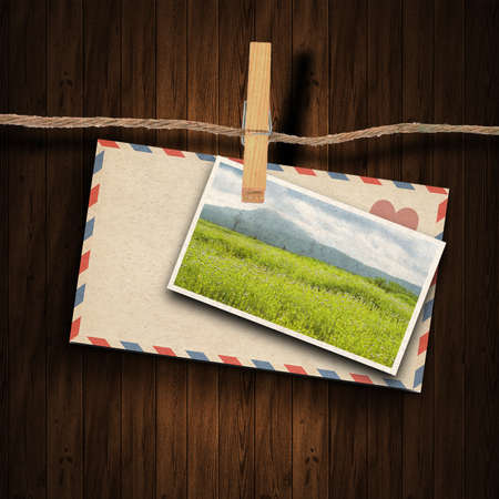 clothes peg:  the old envelope , postcard and clothes peg wood background