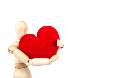 wooden man holding the red heart on white background