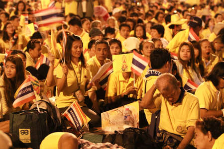 thronged: BANGKOK ,THAILAND - DECEMBER 5: Unidentified Hundreds of thousands of people thronged the Royal Plaza to help celebrate HMs 85th birthday; the King is the worlds longest-reigning monarch. His Majesty ended his birthday speech delivered to all well-wishe