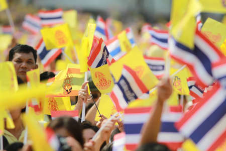 BANGKOK ,THAILAND - DECEMBER 5: Unidentified Hundreds of thousands of people thronged the Royal Plaza to help celebrate HMs 85th birthday; the King is the worlds longest-reigning monarch. His Majesty ended his birthday speech delivered to all well-wishe