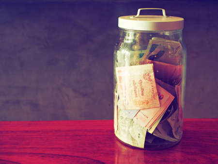 avarice:  money in bottle vintage color tone