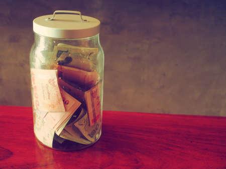 money in bottle vintage color tone  photo