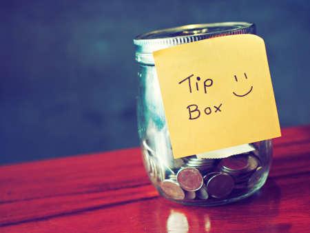 coin in money jar Tip box Standard-Bild