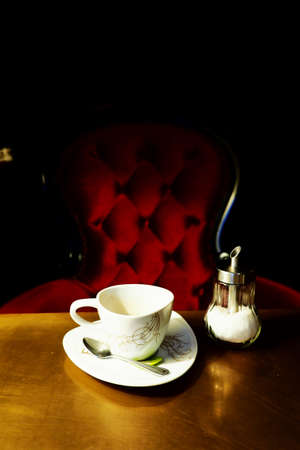 cup of coffee in coffee shop vintage color photo