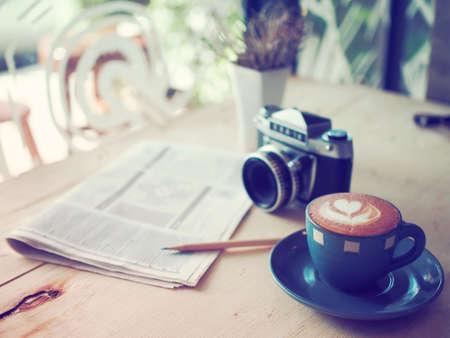 cup of coffee latte in coffee shop vintage color Standard-Bild