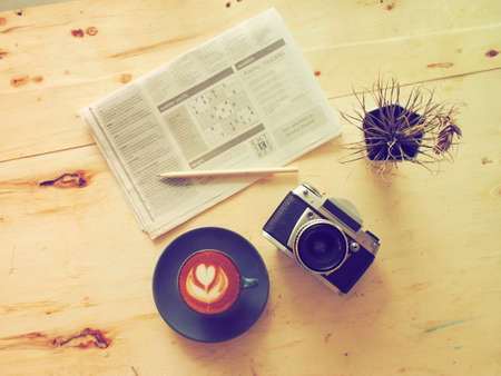 cup of coffee latte in coffee shop vintage color photo
