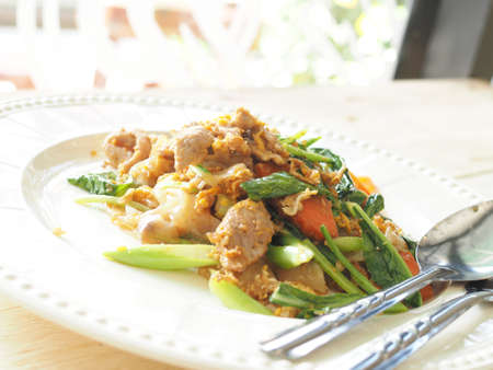 Pad See Ew, Stir fried flat noodle and pork with preserved soy bean paste photo