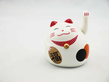 Japan lucky cat on white