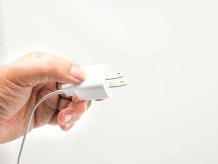 zelektryzować: Phone charger isolated on white . Zdjęcie Seryjne