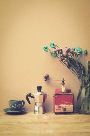 old kitchen: italian coffee maker and flower vintage color style toned Stock Photo
