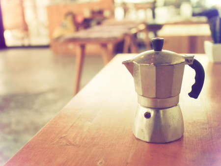 coffee maker, espresso machine on the table wood vintage color