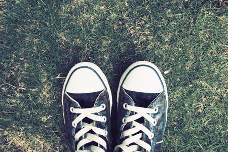 Retro Photo Of Vintage Sneakers On Green Grass