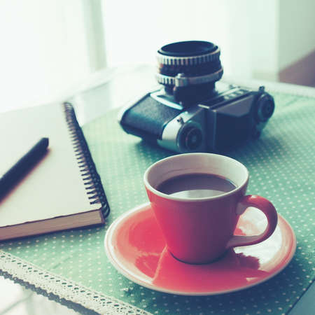 Cup of Coffee in coffee shop vintage color tone style Stock Photo