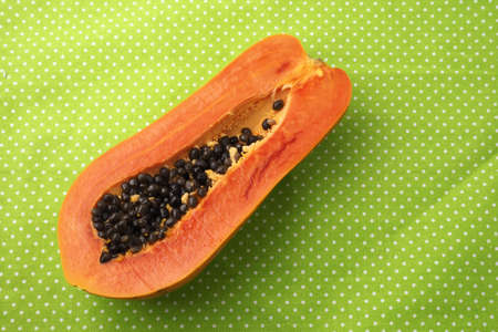 grope: Papaya on the green background Stock Photo