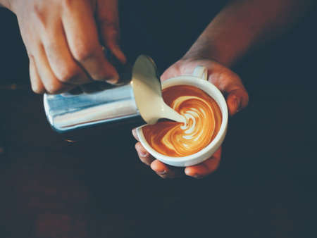 vintage color tone of  cup of coffee latte art