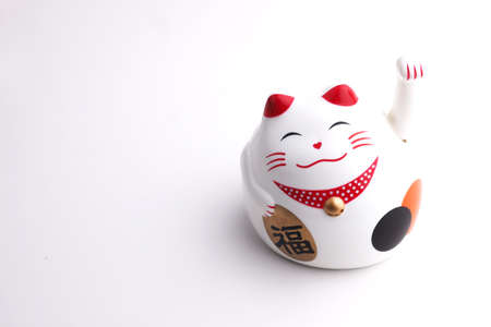 fareast: Japan lucky cat on white background