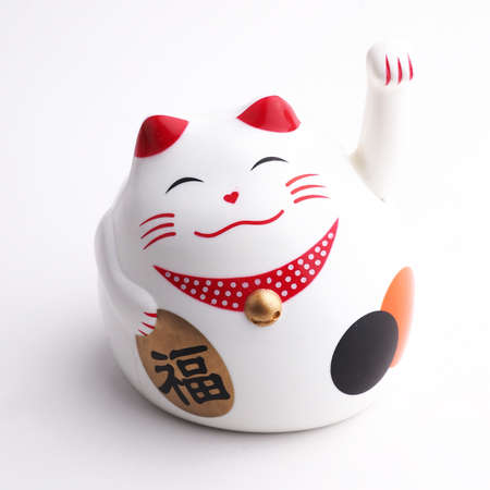 Japan lucky cat on white background