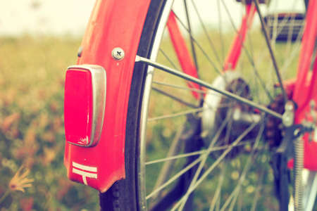 color tone: vintage red bicycle in vintage color tone Stock Photo