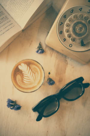 cup of coffee latte art on the wooden desk photo