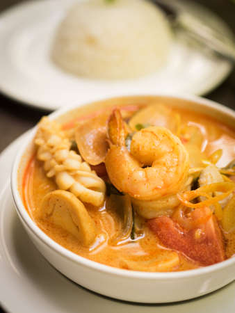 gung: Thai food : Tom Yum sea food soup on the wood texture