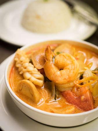 pla: Thai food : Tom Yum sea food soup on the wood texture