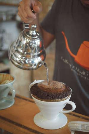 coffee dripping in coffee shop vintage color tone Standard-Bild