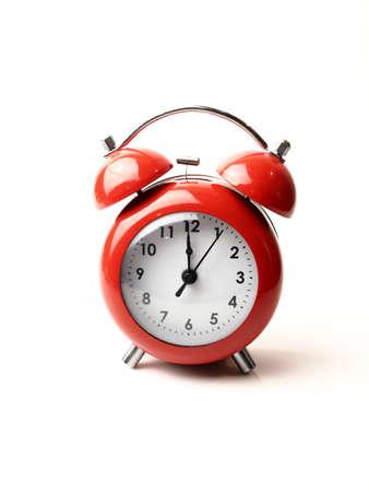 12 oclock: vintage retro red alarm clock 12 oclock isolate white background Stock Photo